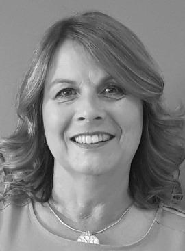 A grayscale headshot of Carole